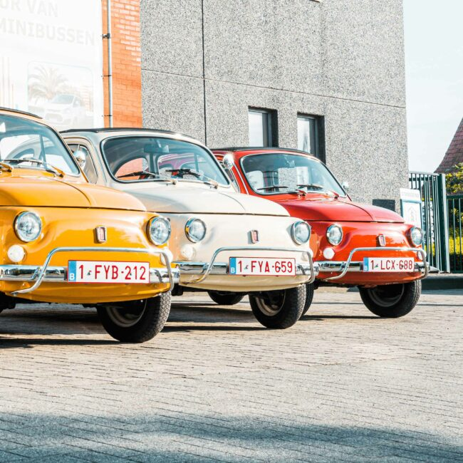 gele, witte en rode Fiat 500 Rent & Go